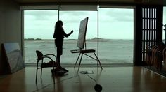This short documentary follows Howth based artist , Una Sealy RHA. Una has previouly painted  a large winter painting, of a view of  Clontarf, This winter Una choose Baldoyle estuary, an iconic place from her youth as her subject matter. Over a period of months from December 2015 , Una is seen worked from the large meeting room of the award winning  Baldoyle Library, designed by FKL Architects,on Strand Road, which commands excellent views of Irelands Eye, and the estuary in all its…