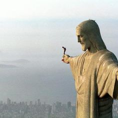 Christ over Rio. Man skydiving from his hand.