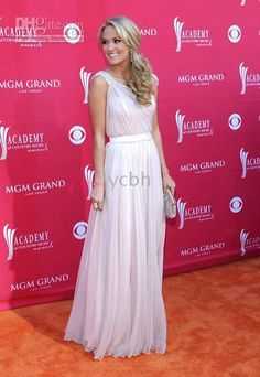 One shoulder drape-style maxi dress with waist belt.