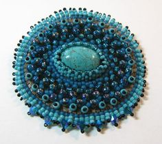 Bead embroidered turquoise pendant