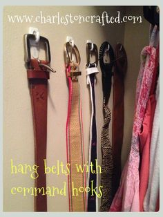 Organize belts by hanging them on the wall using Command™ Brand Hooks.