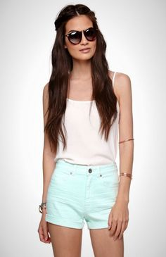 High-waisted shorts are all the rage. Mint is all the rage. Combine them for a fresh, casual look. Add some oversized sunnies
