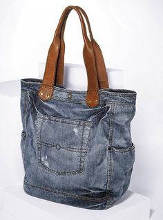 Upcycled denim bag with plenty of pockets.