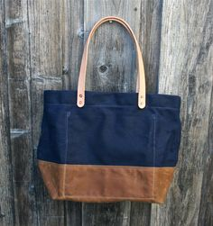 Strong, durable and water resistant waxed canvas tote bag. Perfect as your carry-all, weekender, school bag, or market bag. Handmade in Santa Cruz, Ca on a vintage single-needle sewing machine.