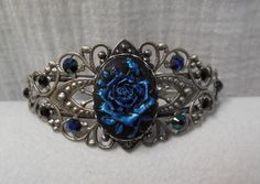 I found 'Antique Silver Filigree Bracelet. Hand Painted Black & Blue Rose Cameo. Capri Glacier Blue Swarovski Crystal accents' on Wish, check it out!