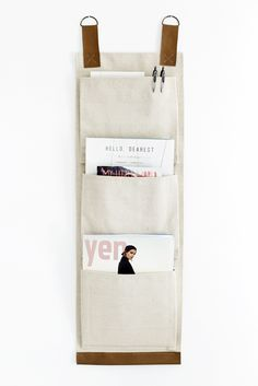 These leather and canvas wall pockets are a useful and stylish way to add a little extra storage to any room in your home! Click for the tutorial for these wall pockets!