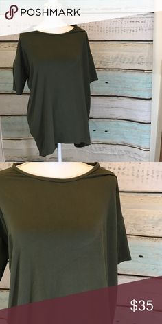 Xs LulaRoe Irma tunic Xs LulaRoe Irma tunic.   Olive green in color.  Legging material.  Oh so so soft LuLaRoe Tops Tunics