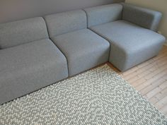 This is a carpet designed for molekule by a Norwegian blogger Andrea Gravningen. It is so beautiful in its simplicity.Andrea  used just two colours: white and very light grey. The photo is from our living room to show how Andrea's carpet looks next to the grey sofa. #sofa #grey #carpet #molekule #kuleteppe #feltballrug #ballrug #livingroom Sofa Sofa, Couch, Felt Ball Rug, Gray Sofa, Grey Carpet, Carpet Design, Carpets, Colours, Living Room