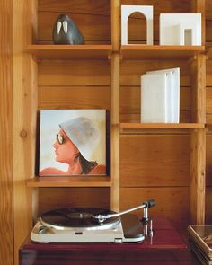 Shelf Life:   The family use built-in bookshelves throughout the house to display their favorite treasures. Here, those include maquettes by Roy McMakin of their former home, a sculpture by Futao Fujii, a Thorens turntable, and a portrait of Dewey's mom in the 1970s painted by his father.
