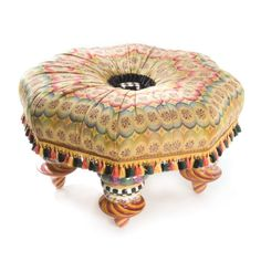 Breezy Lake House style lends an easygoing attitude to any space. Cushion is made of vintage-weave polyester fabric in a soft multicolor palette, topped by a checked button with a black grosgrain ribbon ruffle, and trimmed with tassels. Each Lake House Setting Seat is handcrafted at our lakeside Aurora home, naturally. Add a glass top (not included) for a one-of-a-kind coffee table.
