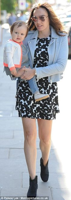 Stylish: Tamara looked typically fashionable in a monochrome print minidress and cropped i...