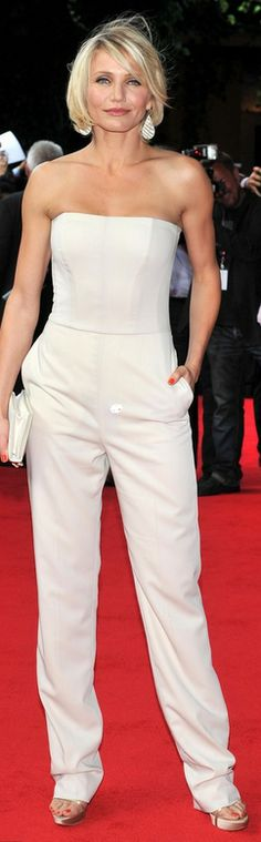 Who made Cameron Diaz's jewelry, platform sandals, clutch handbag, wide leg pants, and strapless white top that she wore in Cannes on May 22, 2012?