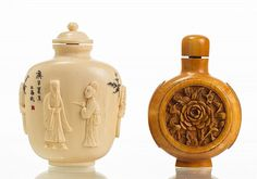 Two Chinese Ivory Snuff Bottles. The larger bottle is carved with figures and has lion head ring handles. It is scrimshawed with a mountain and village scene on the back and is also inscribed with various Chinese characters. Measures 2.7 inches in height. The smaller bottle is a later stained ivory snuff bottle, with a floral carving on one side and a multicolored scrimshawed scene of cranes on the other side. It is signed. Measures 2.5 inches in height.