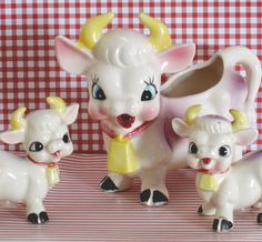 A fantastically cute set of a kitschy cow and her calves. The cow is a pourer, almost like a teapot, and her calves are salt & pepper shakers.