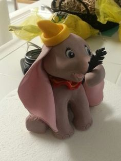 Dumbo cake topper - Hand sculpted from modeling chocolate and overlaid with fondant 'skin'. Made thus for a friends little girl, as a topper for her birthday cake.