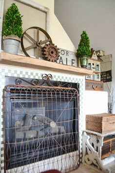 This cottage was so cute to visit...looking for a fence just like this one for the fireplace - makes a super sweet fire screen....Down to Earth Style: Cottage Style Home Tour