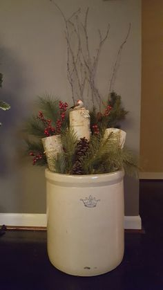 Holiday greenery, Birch logs, teigs and lights in an antique crock. Holiday greenery, Birch logs, teigs and lights in an antique crock. Christmas Planters, Christmas Porch, Primitive Christmas, Country Christmas, Christmas Projects, Winter Christmas, Vintage Christmas, Christmas Holidays, Christmas Ideas