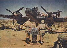 Germans loading a camera Africa,1942. Aircraft is a Messerschmitt Bf 110.