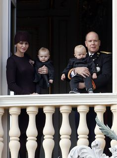 Princess Charlene of Monaco holding Princess Gabriella and Prince Albert II of Monaco holding Prince Jacques appear on the balcony of the Monaco Palace during celebrations marking Monaco's National Day on November 19, 2015.