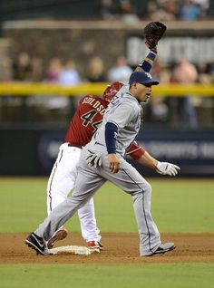 Yunel Escobar #11 of the Tampa Bay Rays holds up the ball after tagging out Paul Goldschmidt #44 of the Arizona Diamondbacks at Chase Field on August 7, 2013 in Phoenix, Arizona. (Photo by Norm Hall/Getty Images)