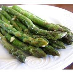 Sauteed Garlic Asparagus Recipe - use EVOO instead of butter, cut the cooking time, add splash white wine at the end - ;)