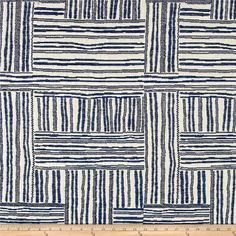Designed by Justina Blakeney, founder of The Jungalow™, this very heavyweight (16 ounces per square yard) jacquard fabric features an abstract cross hatched pattern with subtle chenille accents. It's modern with a touch of quirk, great for an accent or a chic, unexpected all-over moment.  This fabric is perfect for upholstery projects like headboards, cornice boards, ottomans, slipcovers, and more. Colors include indigo and cream.