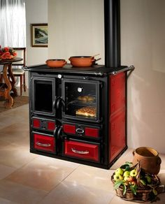 wood burning range cooker / boiler EMILIANA MET MANN - I would definitely get this for an old country home....