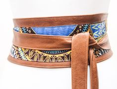 Tan leather Dashiki Wax Print corset belt is made from real leather and real wax print from Ghana in West Africa.  This beautiful belt will accentuate your style be it casual or formal. Cinch in your waist and get instant curves and a flatter tummy  Featured pictures  Size small Tan - 4 inches wide