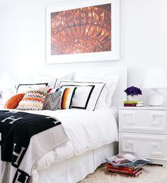chunky white greek key inspired nightstands.