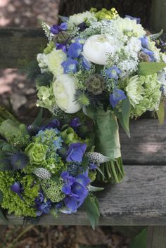 Pretty bouquets - perhaps place them in a tea pot or pitcher (NOT clear glass, lead crystal or antique clear glass is ok).  Use pink flowers in with the white & purple.