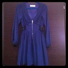 Navy blue and black dress by Lipsy. I am Re-Poshing because it doesn't fit at all.  It's a size 4 and true to its European size.  Material is not stretchy so don't buy it unless you're a true size 4.  It's such a beautiful dress.  I'm really sad it doesn't fit. Lipsy Dresses Long Sleeve