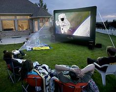 Backyard Inflatable Drive-In - Everything's included. Slide a DVD into the player and the digital projector beams the movie onto your choice of a 10-foot or 12-foot wrinkle-free, inflatable movie screen (with a blower fan for 30 second inflation). There's also a sound mixer, LED light to aid in nighttime set up, and all the cables you'll need. When the movie's done, the whole thing goes into a carrying case for easy storage.