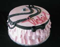 Pink sugar ruffles and black pearls for a very fashion conscious lady. By thecakeattic.com in Salisbury, NC www.facebook.com/thecakeattic