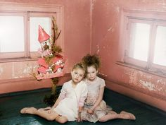 Katrina Tang Photography for Mon Petit SS 14. Two girls wearing dresses sitting on a floor, castle, old house #katrinatang #tangkatrina
