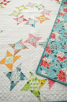 I backed it in my favorite Flea Market Fancy print and machine bound it in a teal print from Domestic Bliss from Moda. I love the way it tu...
