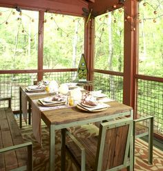 A screened porch on the back of the house is decked out for dining. Overlooking the woods and lake, dinner music is the chirping of birds and the splashing of fish. The tin roof and vaulted ceiling overhead make light rain most delightful.