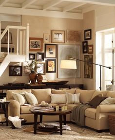 I love the neutrals in the room, the picture arrangements, and the cozy feel that all the elements create together.