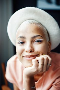 Model Kota Eberhardt Talks Racism in the Industry, Beauty, and More: Here's what she had to say about being discovered by Bruce Weber, the day she learned to love her hair, experiencing racism, and more. -- Blush pink top with white beret. | Coveteur.com