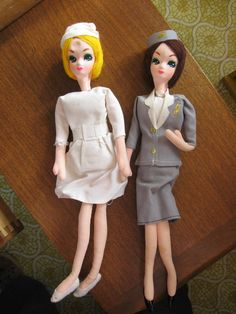 Stewardess had 'patent leather' black vinyl shoes. Nurse has fuzzy cloth slippers. Dimple dent in forehead of the nurse. Stain on Stewardess's leg. We are guessing their origins based on other similar dolls. | eBay!