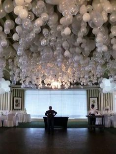 put a marble in a (helium) balloon and get a fantastic balloon ceiling! they float upside down due to the weight of the marble!