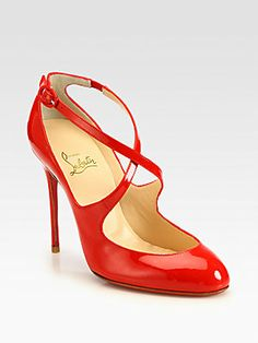 "Christian Louboutin Vita Dita Patent Leather Mary Jane Pumps in Red.    A piercing heel elevates this sexy patent leather design with intersecting straps.  Self-covered heel, 4"" (100mm)  Patent leather upper  Adjustable ankle strap  Leather lining  Signature red leather sole  Padded insole  Made in Italy"