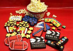 Sweet Hope movie cookies with popcorn, tickets, mvie reels, dots, boards