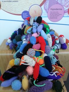 A mountain of knitted #microbes but, we need more!  Find out how to help: http://www.glasgowcityofscience.com/get-involved/knitting-microbes