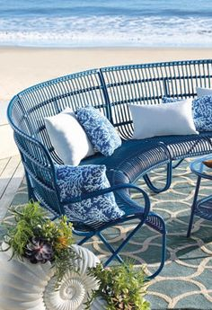 This shot inspires me to take a dream vacation.  Love the how the blue furniture contrast the natural hues of the ocean!
