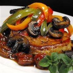 Pork chops are simmered until very tender in a mushroom tomato sauce with Italian seasonings.