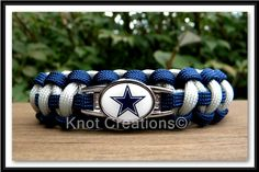 Dallas Cowboys paracord bracelet with Officially Licensed charm attachment.