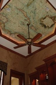 I love this map on the ceiling.  This would especially be great in a library or den.  It would even look great in the boys room who likes geography.  Or in a boy themed pirates room.  Just draw a huge red X somewhere to signify a treasure.  Mark dotted lines from one place to another to signify the way to the treasure.  HAVE FUN with this idea.