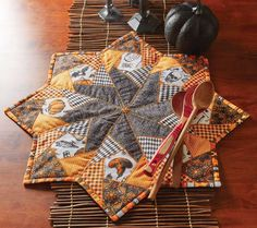 Holiday quilt patterns make great centerpieces! This star-shaped table topper called Crazy for Halloween, designed by Jean Nolte using fabrics by Patrick Lose, has a spooky motif and is made to impress.