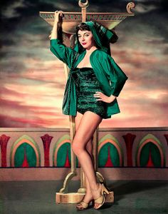A young, captivatingly emerald green clad Joan Collins looking rather seductively gorgeous.