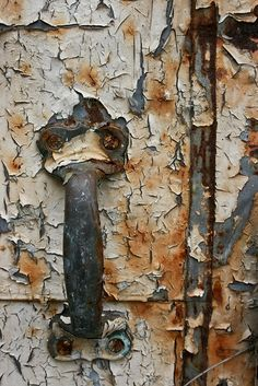 Rusty door handle and peeling paint